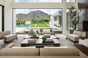 Living room in contemporary custom home with view of outdoor patio and garden