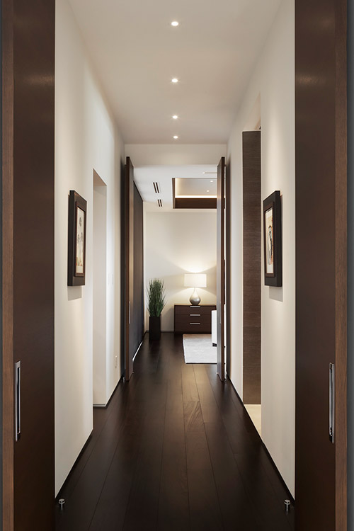 Hallway to bedroom in contemporary custom home