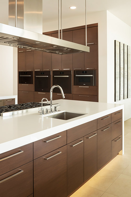 Contemporary kitchen in custom home with dark cabinets