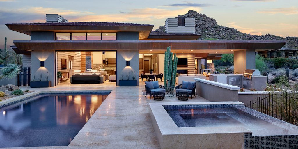 Exterior of desert prairie custom home with pool