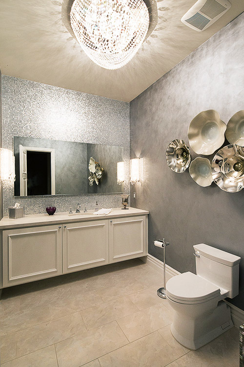 Bathroom in custom home with decorative walls and chandelier