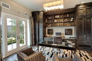 Offie in custom home with french doors and dark cabinets