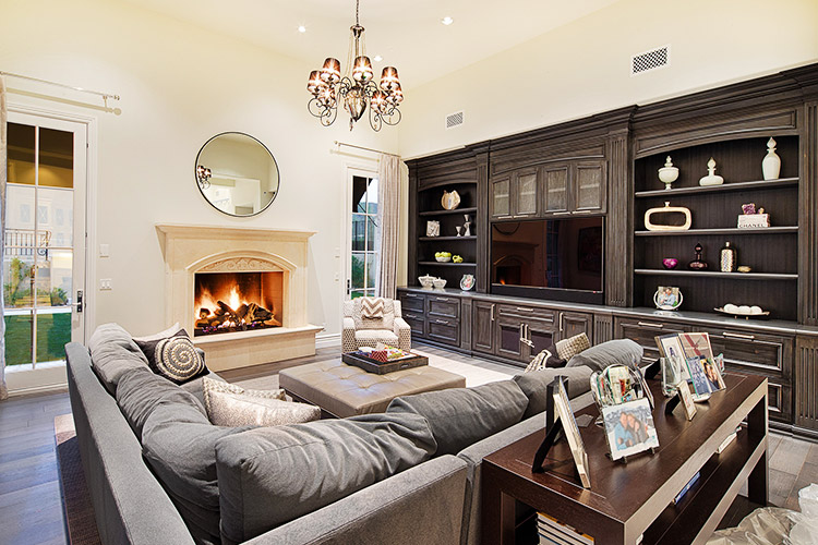 Sitting room with fireplace and built in bookcases in custom home