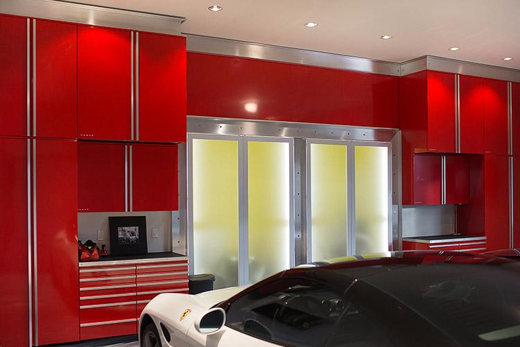 Custom red garage storage in luxury home