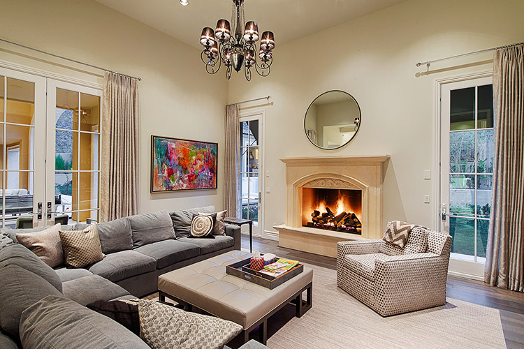 Sitting room in custom home with fireplace and french doors