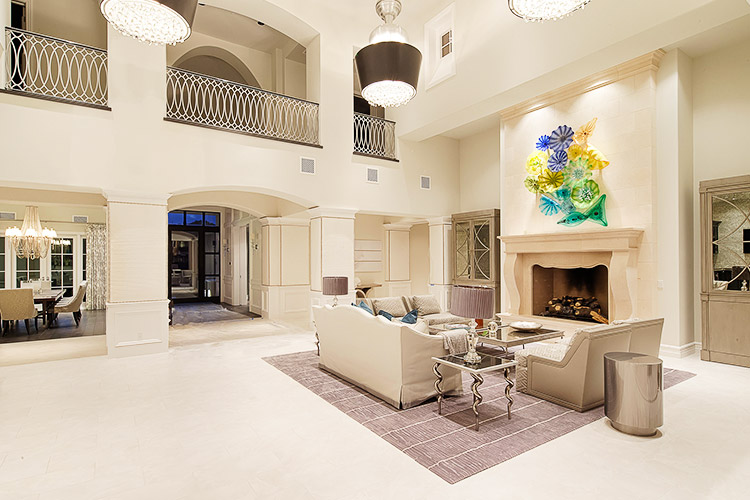Luxury living room that opens to patio in custom home