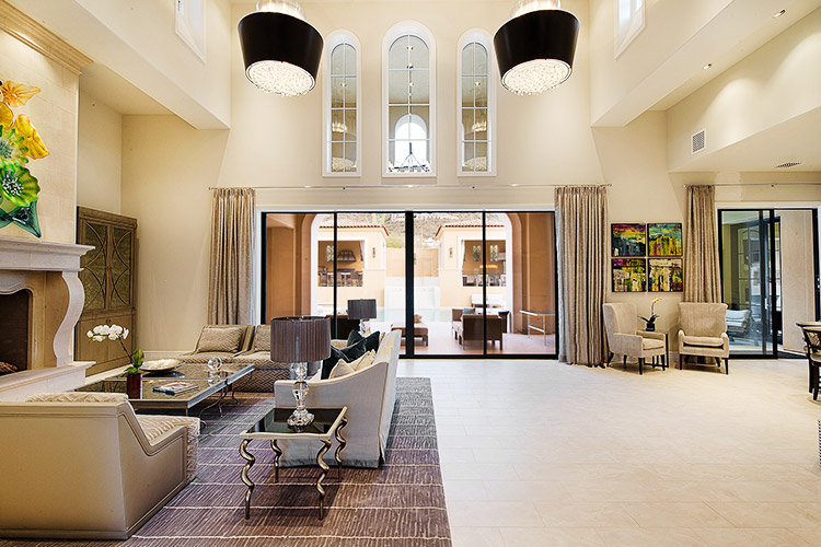 Luxury living room in custom home that opens to patio