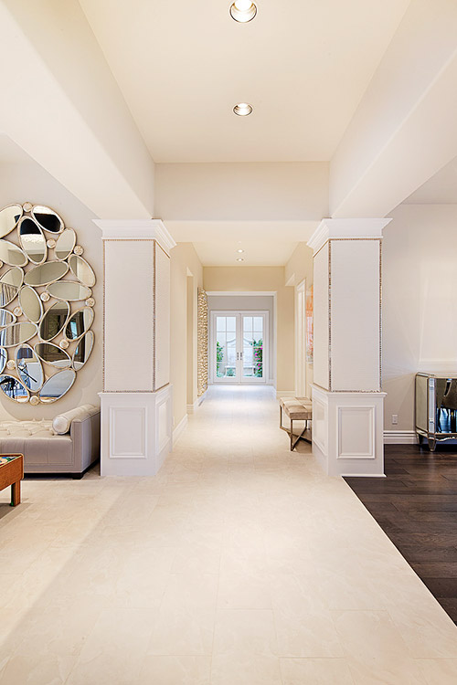Hallway in luxury home with cream floors and walls