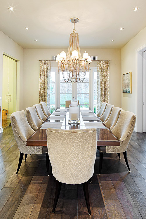 Dining room in custom luxury home with chandelier