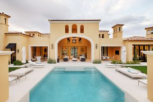 Exterior of custom estate with pool and outdoor seating