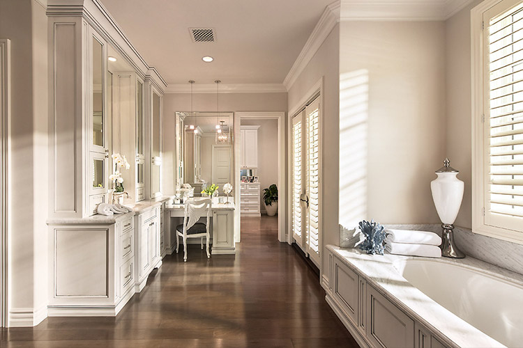 Bathroom in custom home with large bathtub and vanities