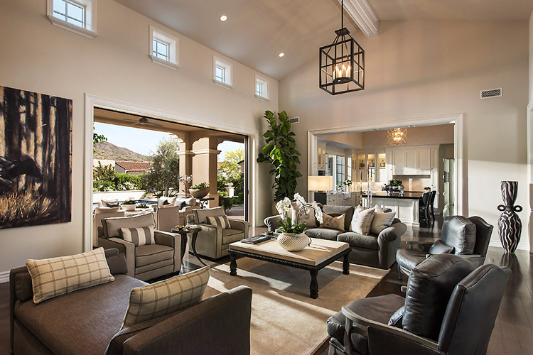Living room in custom home that opens to outdoor living space