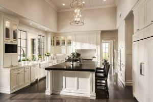 Custom home kitchen with white cabinets and black countertops