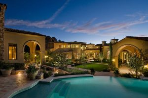 Formal mediterranean exterior with gardens and pool
