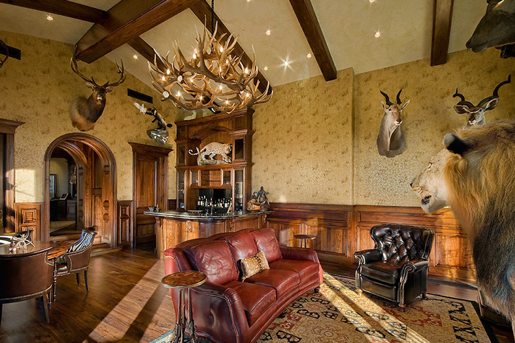 Office in custom home with bar and taxidermy