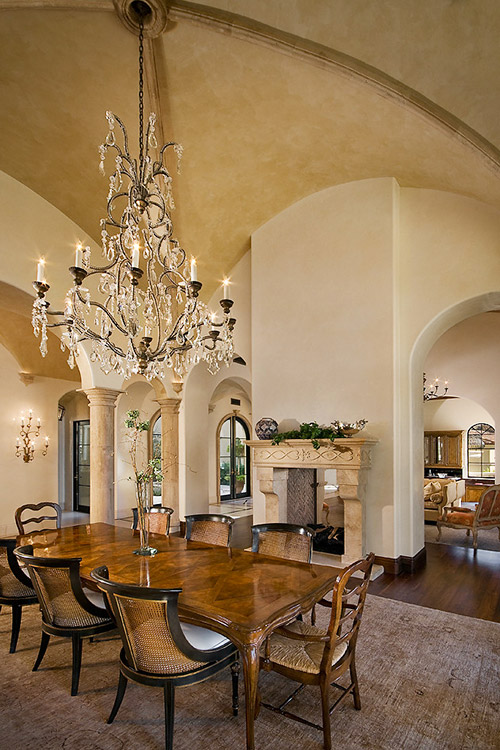 Dining room in custom home with domed ceiling and chandelier