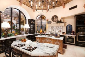 Custom kitchen with domed ceilings and dark cabinetry