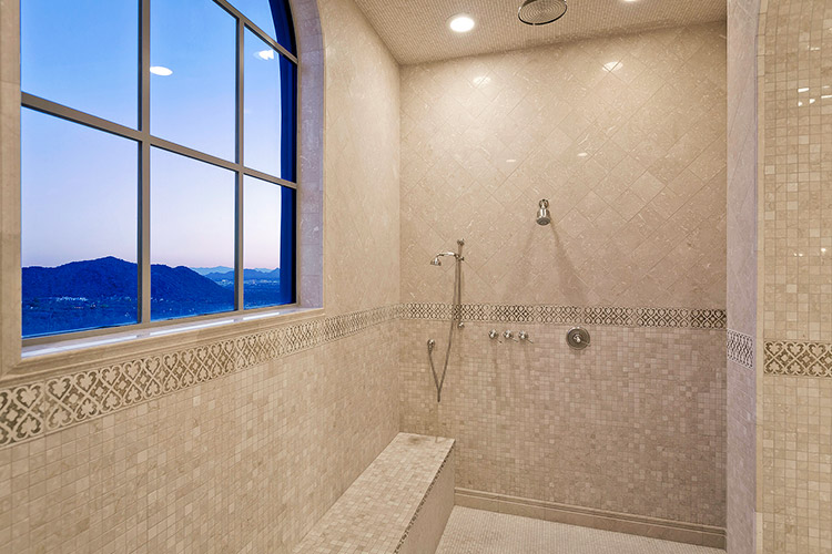 Master shower with view of landscape
