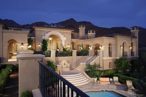 Exterior of luxury custom estate with stairs and pools