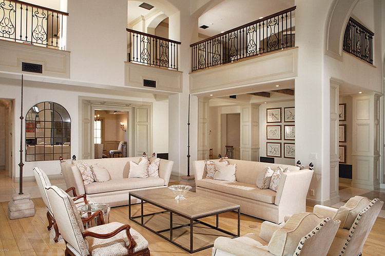 Living room in custom home with fireplace and cream furniture