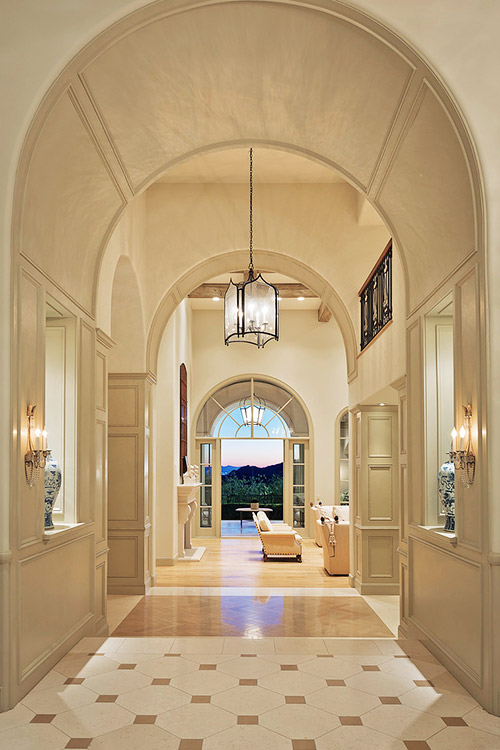 Custom home hallway leading to patio with view