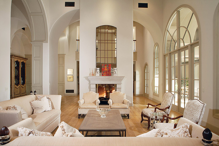 Custom home living room with tall ceilings and fireplace