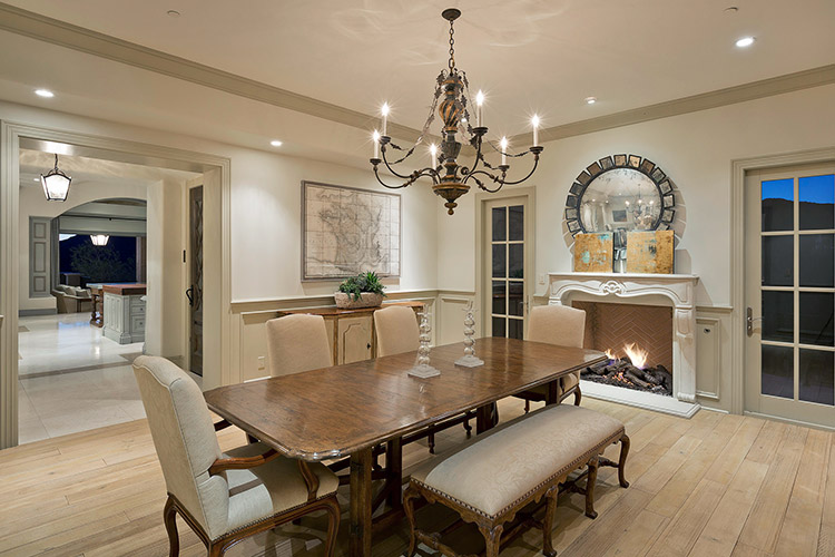 Dining room in custom home with antique accents