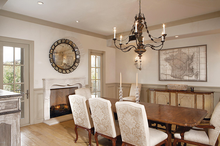 Dining room in custom home with fireplace and antique accents