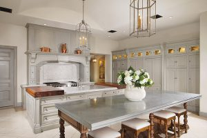 Luxury kitchen with custom cabinets and hanging fixtures
