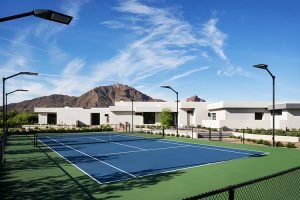 Exterior of contemporary custom home with tennis court