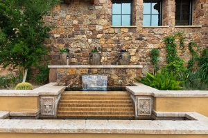 Rural mediterranean custom home exterior fountain