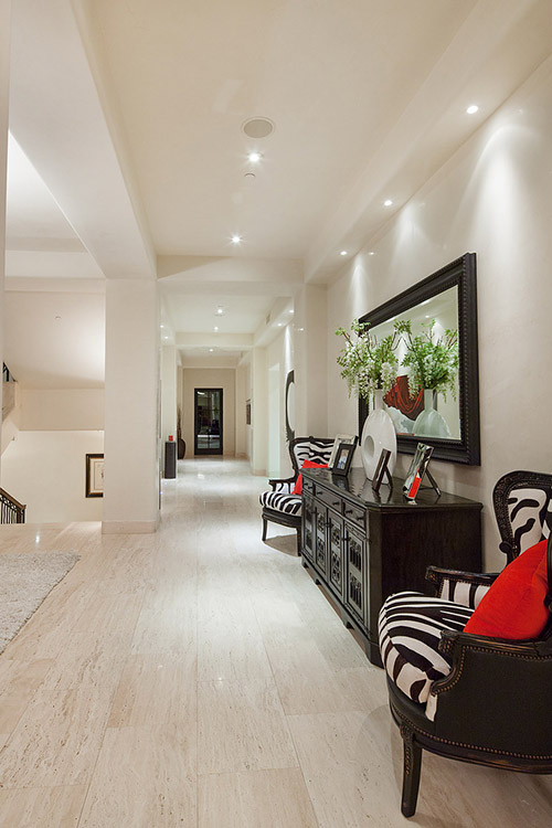 Hallway in custom home with dark furniture