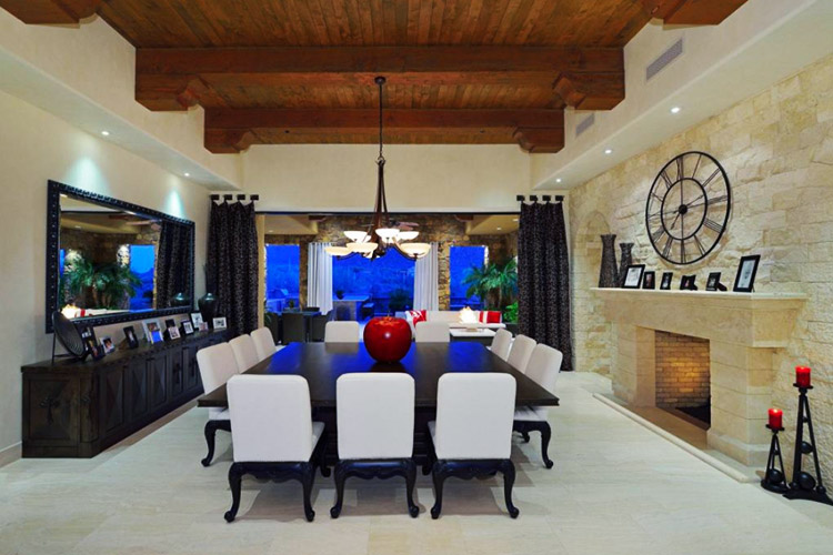Custom dining room with fireplace and beamed ceilings