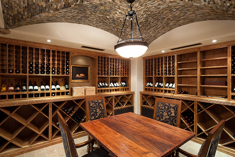Wine cellar with table in custom home