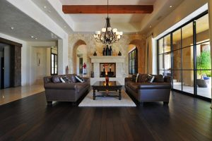 Living room in luxury home with fireplace and stonework