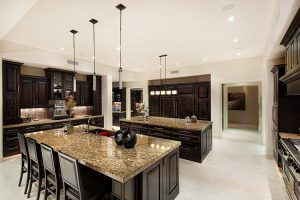 Custom kitchen with dual islands and custom cabinetry