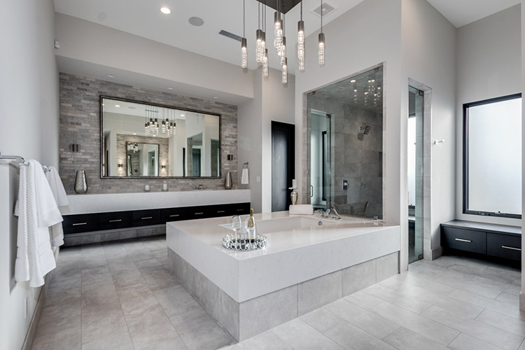 Master bathroom in custom home with sunken tub and expansive vanity