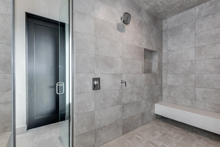 Tiled walk in shower in luxury home