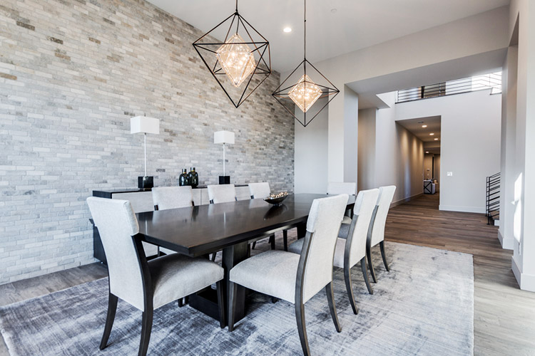 Dining room in custom home with modern furniture and light fixtures