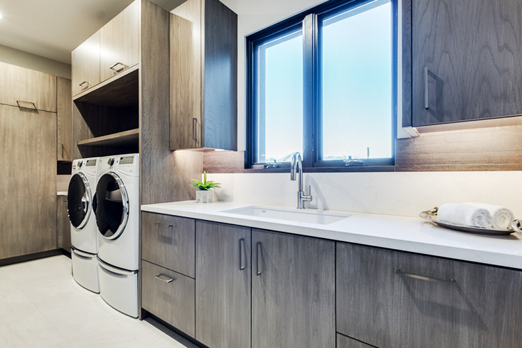 Custom laundry room with sink