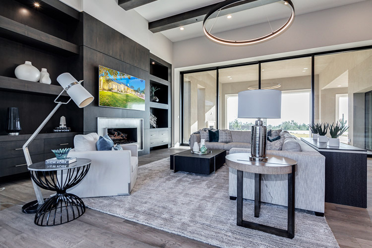 Living room in custom home with view of patio