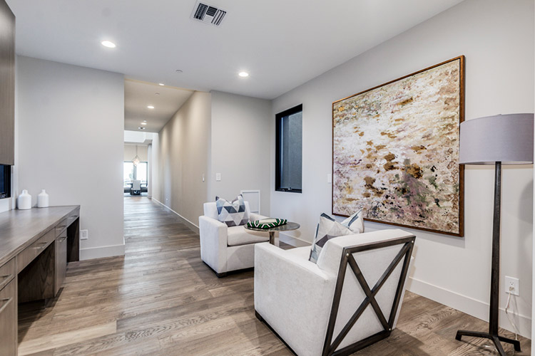 Sitting area in custom home with large, modern painting