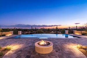 Exterior of custom home with fire pit and pool